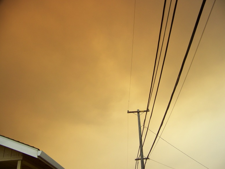 Sepia tone dominate the skies over The Avenues, as a voluntary evacuation notice is given, 7-31-2015